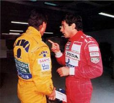 Ayrton Senna giving Michael Schumacher a lecture about driving.