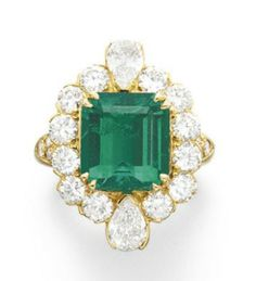 AN EMERALD AND DIAMOND RING, BY VAN CLEEF & ARPELS