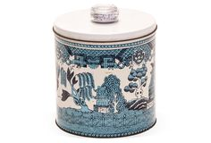 Blue Willow Biscuit Tin used as a flower vase
