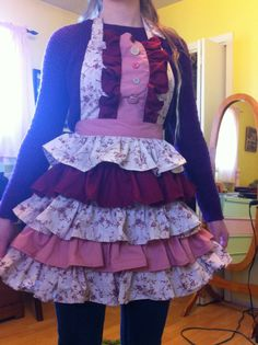 Hand sewn apron with contrasting tiers, ruffles, and buttons; made from vintage sheets by content 2B sew. Sold at Winnipeg Scattered Seeds October 2014.