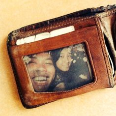 An old photo of 'us' framed in a wallet