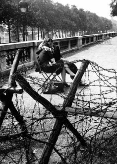 Love and Barbwire; Paris - photo by Robert Doisneau, 1944  Pinned from PinTo for iPad 