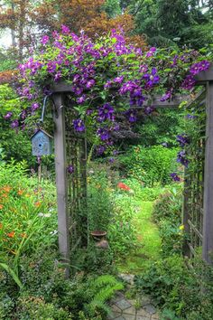 Garden Arbor Covered with Flowers 33 Garden Arbors DIY  Ideas At BackYardCom.com  #backyardcom #landscaping #landscaping ideaspergolacenter