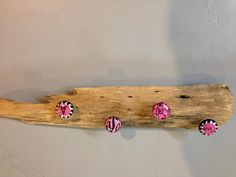 Hot Pink and Black Driftwood Jewelry, Hat, Scarf or Hanger. I had so much fun making this piece because I really love the nice piece of Driftwood and the colors are beautiful! The hot pink and black are really nice for a girls or a women's room. There are hangers in the back so it is ready to hang or you may choose from the other hanging options we send in a separate bag like a chain and eye screws. This is perfect for hanging the dog leash, your jewelry, hats or lightweight jacket.