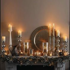 A resplendently beautiful mercury glass and silver adorned Christmas mantle. #mantle #Christmas #decor #decorations #elegant #silver