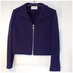 """✨POST✨VINTAGE 60s/70s cropped wool jacket -sleek 100% wool 60s/70s vintage navy blue cropped jacket. Sleek fit, front pockets, heavy zipper, knit stretches a bit. In fantastic condition- no blemishes - but there's some threading bits on the cuffs that indicate there used to be decorative buttons at one time. No size marked but feels like a S/M - judge by measurements: 19"""" armpit to pit, 18"""" shoulder to hem, sleeve 17.5"""" pit to cuff. I'm a busty 6/8 and I LOVE its fit! See pic of me modeling…"""