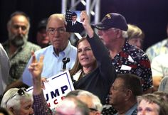 """Donald Trump's running mate quieted the crowd and called Capt. Humayun Khan an """"American hero,"""" when a woman asked him about Trump's comments"""