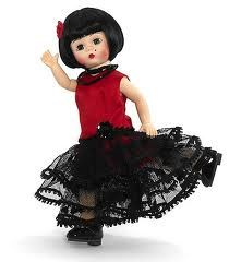 """Wendy Does the Tango - Argentine $67.96 The Tango is ofter called the dance of love and seduction. Wendy Does The Argentine Tango is an 8"""" bent-knee Wendy with green eyes and a brunette bob. She wears a seductive red satin drop-waist dress enhanced by three tiers of black net ruffles trimmed with picot. A black sequin rosette decorates her hip. Her accessories include pantyhose, black patent Mary Janes, a beaded black necklace, and a red rosette in her hair."""