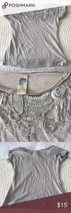 Grey top Women's grey Anthropologie top with intricate silver detail around the neckline. Size small, gently used but in good condition. Anthropologie Tops Blouses