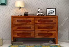 Buy Rahian Chest Of Drawer (Honey Finish) online in India at great value prices. Shop bedroom cabinets online with elegant designs that gives amazing look to your bedroom. Get huge discount on stylish bedroom cabinets online. Visit : https://www.woodenstreet.com/bedroom-cabinets