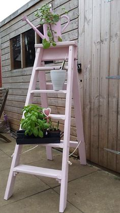 Pink painted ladder for the garden, so cute and retro and great for a plant or herb feature!