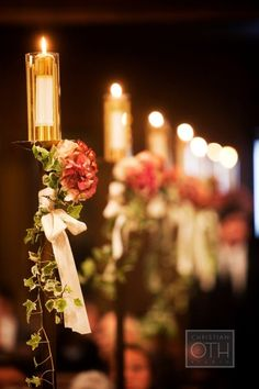 Aisle candles,.. I had these with tulle garland all the way,.. at least 50ft. with ivy sort of like this,..  romantic!