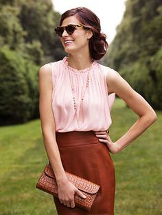 A sweet pink blouse is a divine match for a caramel leather skirt.