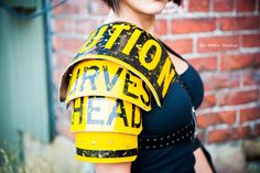 Women's Traffic Sign Shoulder Armor (Fallout, Mad Max, Post Apocalypse). $250.00, via Etsy.