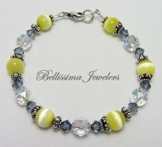 Bracelet with Sterling Silver Bali Beads, Sapphire Crystals and Pale Yellow Cats Eye Beads by Bellissima Jewelers, $79.00 - take 25% off thru Monday, September 16th