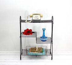 Mid Century Atomic Metal Wire Stand at Atomic Attic on Etsy.  Enjoy!