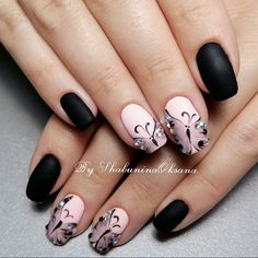 Coupled Matte and Glossy black colors with Glittery enhancement. Boost the look of your hands by covering your nails with this stylish yet attractive nail art design which includes the touch of glittery black nail color along with the base of bold matte black and the tip of glossy shiny nail paint.