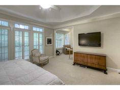 Silk Draperies Disguise An Off Center Window In This Chicago Home 39 S Master Bedroom Windows