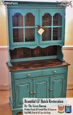 The Green Bureau, www.facebook.com/..., gave this hutch a distressed look with General Finishes Milk Paint. It was first painted with GF Somerset Gold Milk Paint then a layer of Corinth Blue Milk Paint. It was distressed to show the gold paint underneath. The hutch top was also stained with our Java Gel Stain. Learn more about distressing here, youtu.be/DQilIHtFxpY #generalfinishes #gfmilkpaint #javagel #distressed