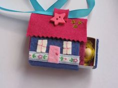 matchbox home-cute! I like that it has a little ribbon handle to carry it.