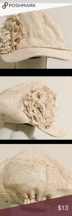 """Natural """"Paper Boy"""" Hat w/Lg Ruffle Flower This cute Natural colored hat by """"D&Y"""" is sooo sassy!! Made of 100% Polyester and has large ruffled flower on right side!! Worn once and had small makeup staining on inside of rim. Looks new though!! No trades. Smoke free home. Happy PoShIng!!😊🌟 D&Y Accessories Hats"""
