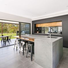 @weston_kitchens clever use of Caesarstone Rugged Concrete in this sleek modern style with an industrial edge. Monumental island base matte black cabinetry alongside live timber elements #caesartone #caesarstoneau #ruggedconcrete #industrialdesign