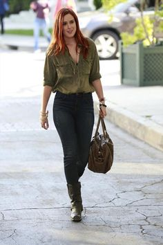 Zoe wearing army green blouse, jeans, biker boots and brown tote bag