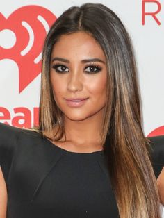 Shay Mitchell's Serious Smoky Eye. Go heavy on your kohl liner. Apply it all around your eyes, then use the tip of a makeup sponge to blend it out for a super dramatic effect. Don't forget your black mascara!