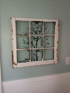 Old window decoration put a tree in window and framed photos of ancestors around it