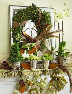 Nature's mantel      To jazz up a boxwood wreath, we tucked in hypericum berries then wired on a magnolia branch, feathers, pinecones and an antique bugle. Finally, we wrapped burlap ribbon around the wreath. A blanket tops the mantel, and we made a small tree by covering a floral foam cone in boxwood clippings.