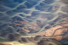 Aerial Photographs of Volcanic Iceland by Andre Ermolaev  At first glance these photos by Andre Ermolaev look like twisting abstract paintings, but in reality are aerial photos of rivers flowing through Iceland's endless beds of volcanic ash.