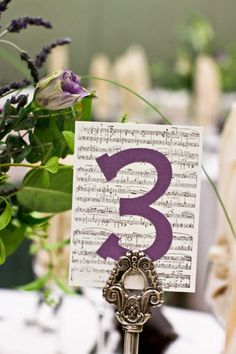 Place cards/Table numbers with sheet music, instrument names as table names - this is such a great idea and I know exactly who would love it.