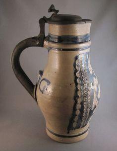 broken and repaired German beer pitcher