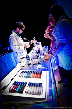 This Glossbar adds a glamorous touch to any event by having your guests design their own color cosmetic. Each lip gloss is custom-made in 60 seconds and given in hand while it is still hot. Men can enjoy too, as a personalized lipgloss makes a great gift for a friend, lover or family member.  This concept has already made it's mark in many corporate events, product launches, cocktails, weddings, bachelorettes, nightclubs. The Glossbar has been seen in Montreal, Quebec, Toronto and Vancouver.