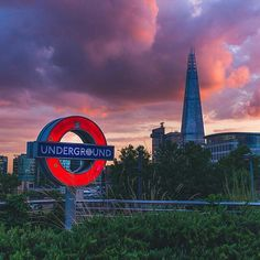 """Our first """"proper"""" theme of 2016 begins today and this week we're going #underground with #thetube! For our first feature of the series @korayhussein brings us this lovely photo of a #londonunderground sign lit up at #sunset in front of #theshard. For those curious this is #towerhill station! ------- Follow for more amazing photos of London every day! ------- #ig_underground #undergroundcity #undergroundlife #theunderground #tube #londontube #undergroundlondon #subways #undergroundstation…"""