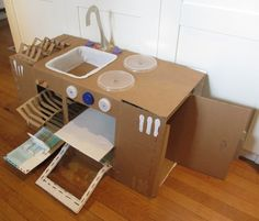 Collapsible play kitchen made from recycled post consumer waste