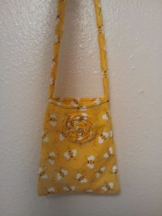 My first purse! Bumble bee fabric! (or choose another cute fabric!) $9.00 has a pocket inside, contact me @ www.facebook.com/tifaniestreasures ... I will make a custom etsy listing for you!