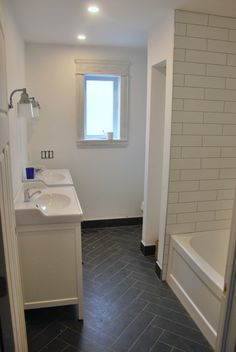 herringbone floor the bathroom design - latest happenings - the sweetest digs Bathroom Floor Tiles, Bathroom Renos, Grey Bathrooms, White Bathroom, Black Bathroom Floor, Shower Tiles, Upstairs Bathrooms, Kitchen Tile, Basement Bathroom