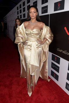 Rihanna Photos Photos - Recording artist Rihanna attends the 2nd Annual Diamond Ball hosted by Rihanna and The Clara Lionel Foundation at The Barker Hanger on December 10, 2015 in Santa Monica, California. - Rihanna and the Clara Lionel Foundation Host 2nd Annual Diamond Ball - Red Carpet