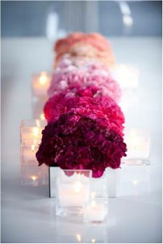 Creative ombre effect done with vibrant bouquet of carnations.