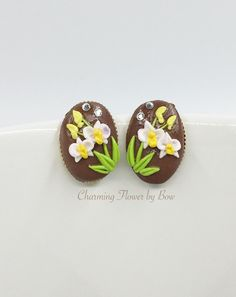 A personal favorite from my Etsy shop https://www.etsy.com/listing/262331335/white-orchid-flowergold-plate-oval-stud