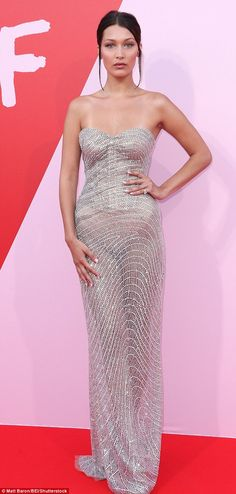 Oh Bella! Hadid was also present wearing a show-stopping silver embellished gown...