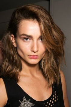 Andrea Diaconu for Emilio Pucci SS14 with messy side part and bold brows. Loving this look!