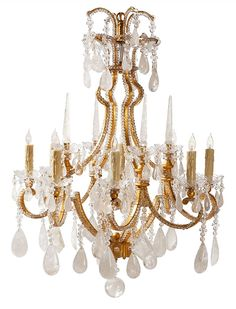 Marseille Chandelier by Ebanista - 8-Light chandelier. Hand-forged wrought iron frame in antiqued gold finish. Clear crystal beading and hand carved and polished semi-precious rock crystal stone prisms. Handcrafted in the USA. http://ebanista.com.