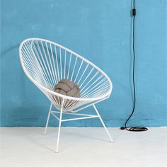 All white Acapulco chair by OK Design.