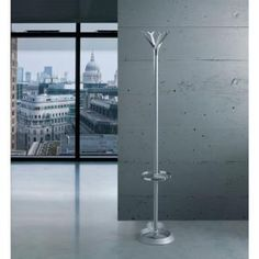 Beautifully designed and crafted, the Basttista coat stand is constructed from steel and features an aluminium crown.Available in Black only with optional umbrella ring. Hat And Coat Stand, Coat Stands, Coat Rail, Coat Hooks, Home Office Furniture Uk, Funky Hats, Acoustic Panels, Terra, Tubular Steel