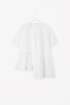 COS image 2 of Top with frill hem in White