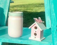 Pretty little bird house and candle/brush holders Too cute!