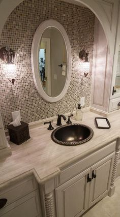 Bathroom Tile behind mirrors. Cabinet design. Arch overhead.