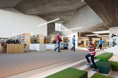 Exposed concrete, timber.   http://www.designboom.com/architecture/jkmm-architects-alvar-aaltos-seinajoki-city-library-expansion/